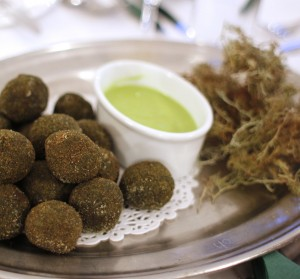 Dock, dandelion and nettle puddings, with crispy lichen and wild garlic mayo